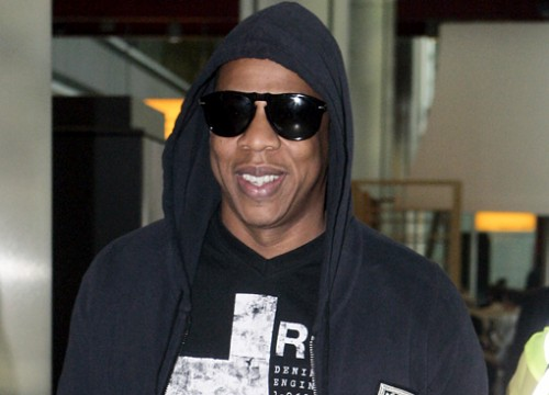 Jay-Z Rolls Up At Heathrow, like Undercover Brother.