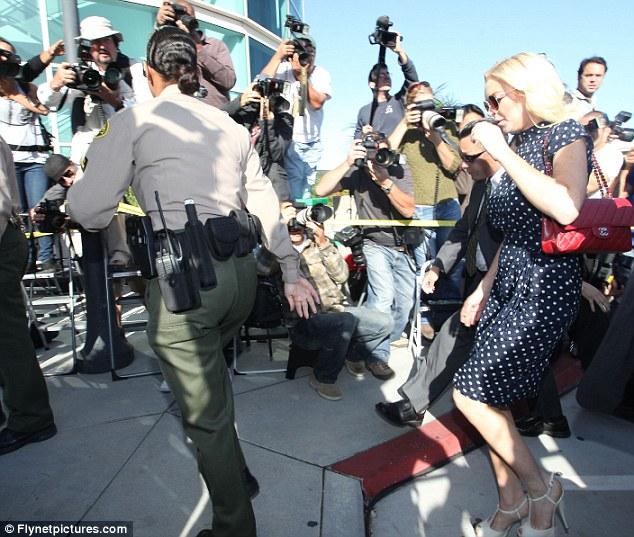 Lindsay arriving in court