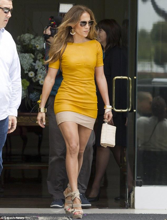 Jennifer Lopez in Peru Killing a Mustard Colored Dress with some Louboutins