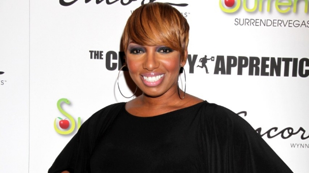 Nene leakes standin in front of the Apprentice Promotional Wall