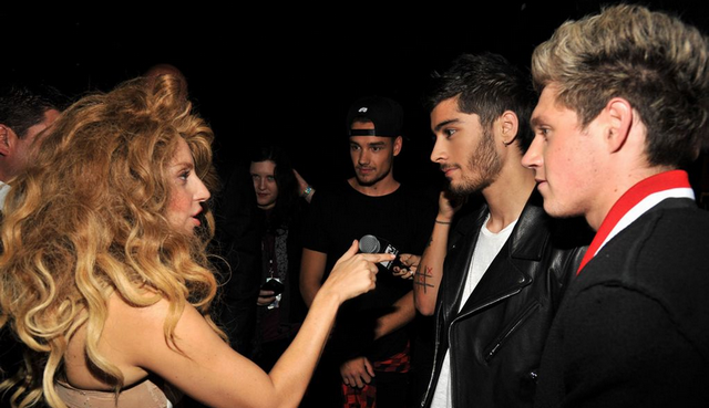 One Direction Booed, Half Naked Lady Gaga Comes To Their Rescue