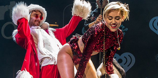 Miley Cyrus Gets New Haircut and Twerks All Over Santa (VIDEO)