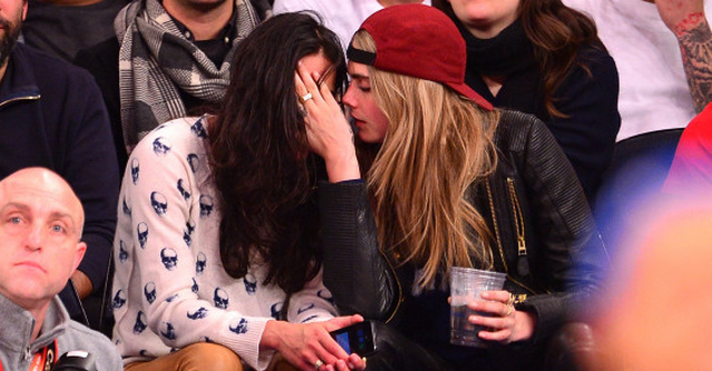 Victoria's Secret Model Cara Delevingne Gets Close To Michelle Rodriguez At New York Knicks Game (PHOTOS)
