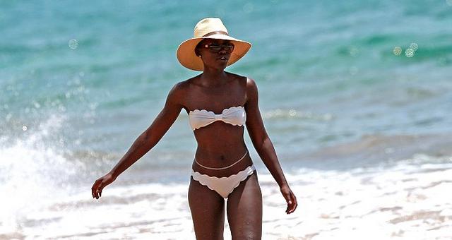 Lupita Nyong'o Shows Off Toned Body In A Strapless White Bikini (PHOTOS)
