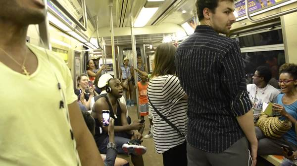 Cast of the Lion King Poses as Passengers and Surprises NYC Subway Riders with Surprise Performance.