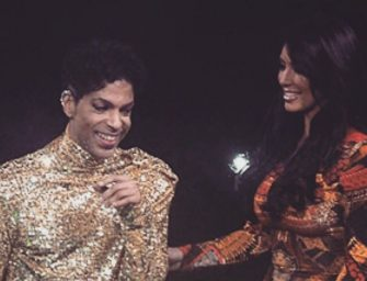 WATCH: The Time That Prince Actually Threw A Younger Kim Kardashian Off Stage During A Live Concert.  (Video)