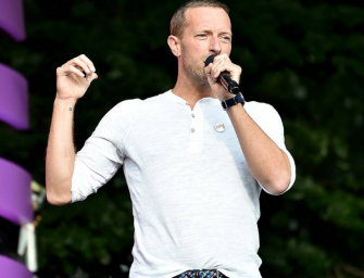 Watch Chris Martin Try His Best To Calm Down Thousands Of People During Global Citizen Festival After A Fence Collapses (VIDEO)