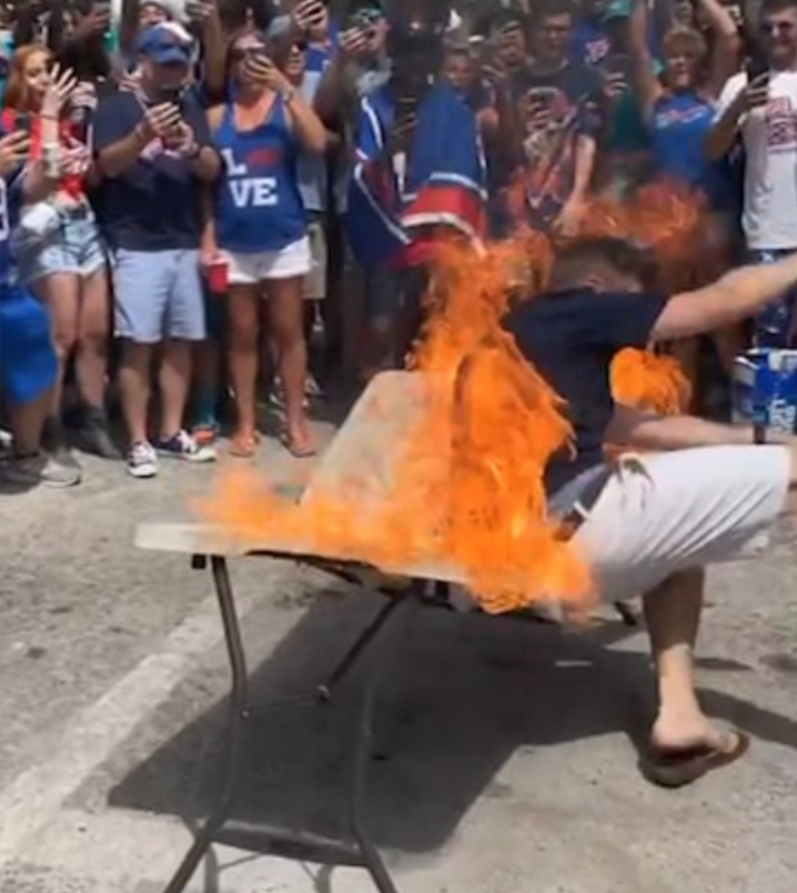 Football Fans Continue To Display Their Poor Decision-Making With Flaming Table Stunt